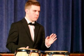 "Will Green accompanies the Riverhead High School Chamber Choir in its performance of ""Gloria."""