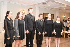 RIverhead High School members of the RBS singers performed the National Anthem.