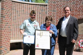 VFW Post Commander Tom Najdzion, left,  with Evelyn DeFrancisco, widow of World War II veteran Danny DeFrancisco, as she receives a proclamation from an aide to Assemblyman Anthony Palumbo.