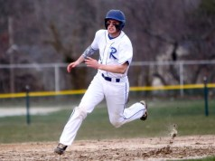 Catcher Cody Smith helped propel the Blue Waves to an 8-5 win over Bellport today. (RiverheadLOCAL photo by Peter Blasl)