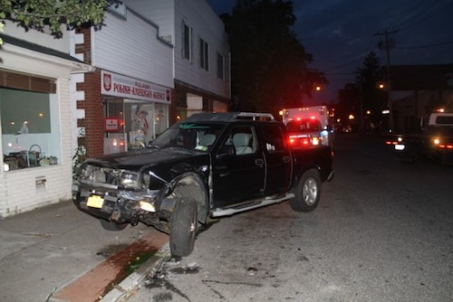 The parked pickup truck on Pulaski Street that was hit by a taxicab tonight. (Photo: Peter Blasl)