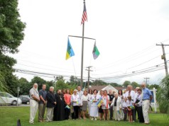 Riverhead Town officials joined the pastor and parishioners of St. John the Baptist Ukrainian Catholic Church outside Town Hall Friday afternoon for a flag-raising ceremony to mark Ukrainian Independence Day Aug. 24. (Photo: Emil Breitenbach Jr.)