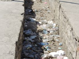 Human waste and trash lines a ditch in the village of O'Rouck. There is no sanitation system in Haiti. Courtesy photo