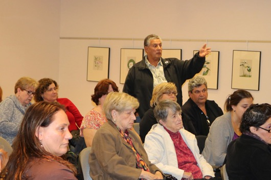 Joe Colao of Riverhead stood to complain about the reassignment of the library's ESL coordinator and other issues. Photo: Denise Civiletti