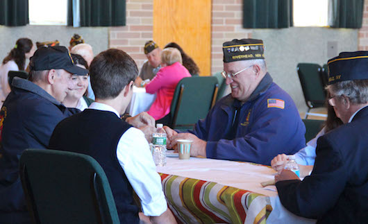 Students hosted veterans for breakfast following the ceremonies Wednesday. Courtesy photo: Bishop McGann-Mercy/Natalie Monar