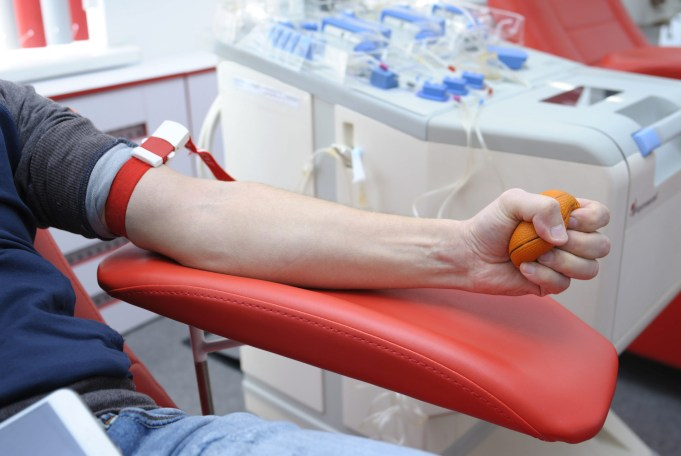 Preparing for taking blood from the vain. Arm pressing a ball for better blood pressure