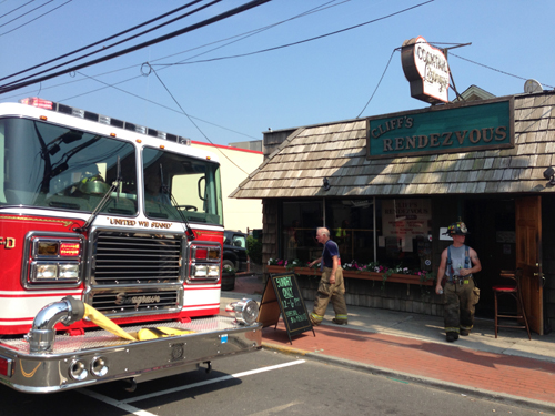 PAUL SQUIRE PHOTO | Riverhead firefighters outside Cliff's Rendezvous after last Tuesday's grease fire.