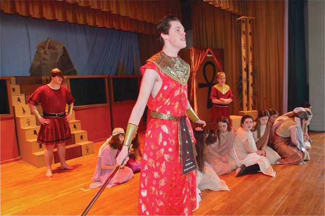 Patrick O'Brien of Riverhead as Radames (in red standing), general of the Egyptian army, during the scene with slaves called 'dance of the robes.' (Credit: Barbaraellen Koch)