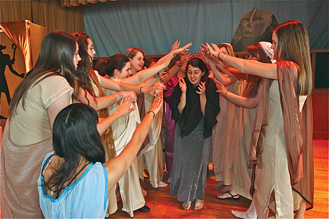 anielle Allen of Riverhead (center) as Aida in a scene with the other captured slaves. (Credit: Barbaraellen Koch)