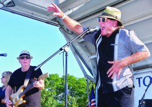 BARBARAELLEN KOCH PHOTO | Gary Utah on vocals and percussion performing with the Bobby Nathan band and Joanne and Bobby Nathan (far left) at 2012's Riverhead Blues and Music Festival.