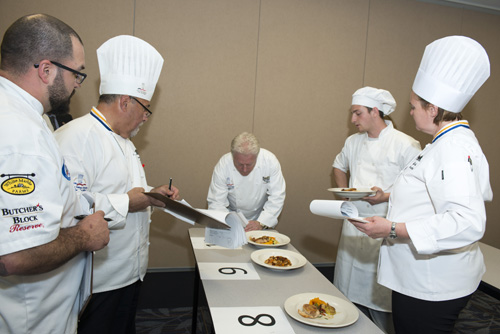 Describing his dish to the judges.