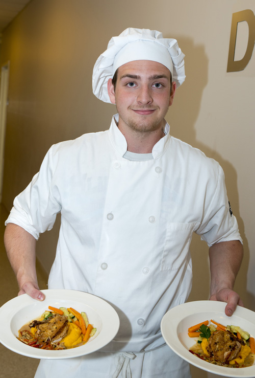 His dish of pan-roasted chicken with a mushroom cream sauce, sautéed vegetables and zucchini, and a sweet potato puree.