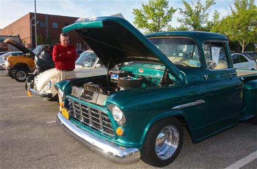 Larry O'Toole of Hampton Bays looks a a 1955 Chevrolet 3100 pickup truck. (Credit: Barbaraellen Koch)