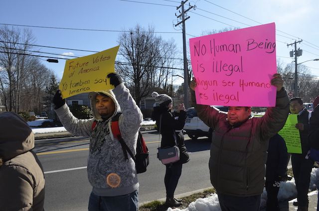 Marchers along Main Street in Hampton Bays.
