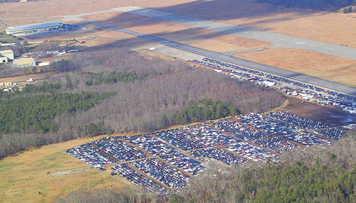 DEC COURTESY PHOTO | Hurricane Sandy damaged cars parked on the grasslands at EPCAL.