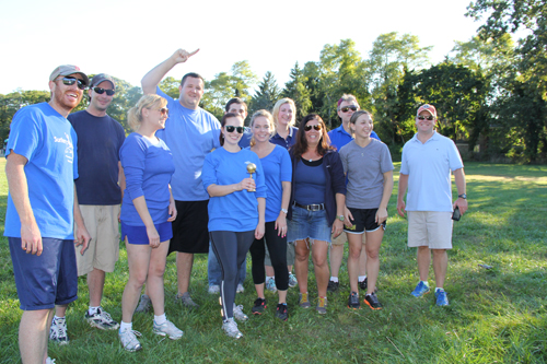 VERA CHINESE PHOTO | The Times/Review Newsgroup team celebrates its victory in the first ever East End Media Kickball Tournament.