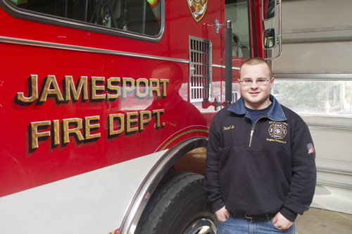 Dan Doroski stands in front of his company's Engine No. 3 at the Jamesport firehouse (Credit: Paul Squire)