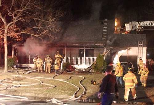 PAUL SQUIRE PHOTO | Riverhead firefighters battle a house fire early Monday morning.