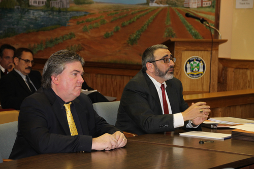 PAUL SQUIRE PHOTO | Attorney Vincent Messina (right) speaks to the Riverhead ZBA with researcher