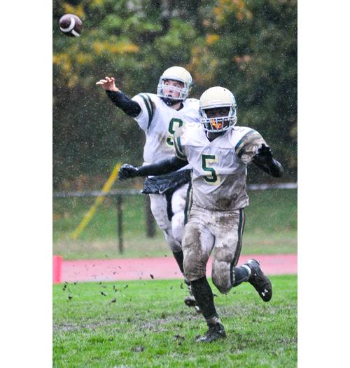 McGann-Mercy quarterback KJ Santacroce lets go a pass as running back Reggie Archer blocks in front. (Credit: Bill Landon)