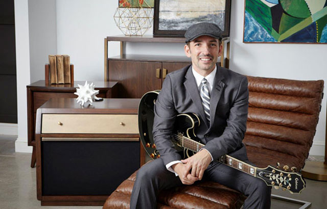 Riverhead jazz guitarist Matt Marshak with some of the pieces he helped inspire for Rhythm & Home, a new furniture line. (Courtesy photo)