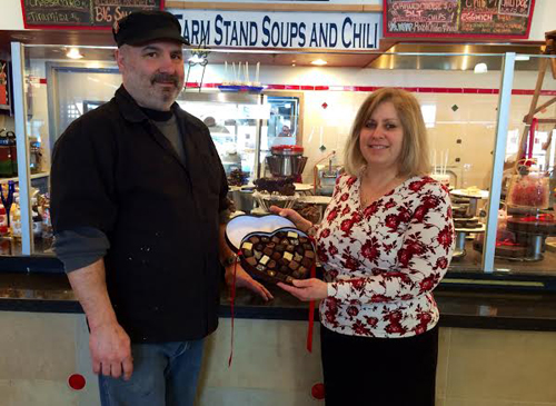 RACHEL YOUNG PHOTO | North Fork Chocolate Company owner Ann Corley, right, with executive chef Steve Amaral at their Tanger Outlets location Tuesday.