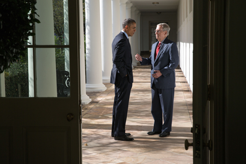 President Barack Obama talks with Senate Minority Leader Mitch McConnell, R-Ky., on the Colonnade of the White House, Nov. 7, 2014. (Official White House Photo by Pete Souza)