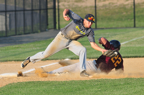 Riverhead Tomcats outfielder Andrew Plunkett slides into third as North Fork Osprey Penn Murfee tries to apply the tag. (Credit: Bill Landon)