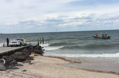 Police return to the shore after they were unable to locate a sailboat that had issued a distress call Sunday afternoon. (Credit: Grant Parpan)