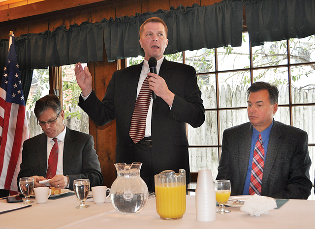 Southold Town Supervisor Scott Russell (center) speaks during a panel event Feb. 26 hosted by the Long Island Board of Realtors at Greenport's Townsend Manor Inn. He's flanked by Riverhead Town attorney Bob Kozakiewicz (left) and Suffolk County Legislator Al Krupski. (Credit: Rachel Young)