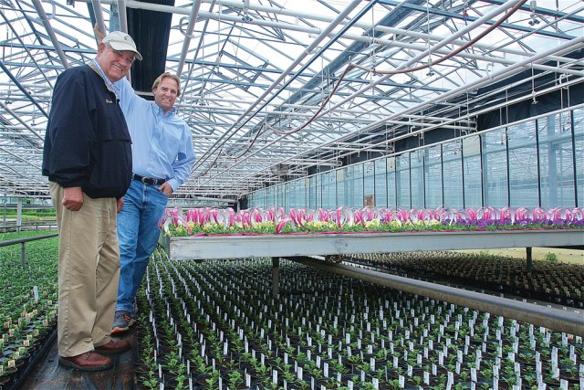 Jack Van de Wetering and his son Kurt in a climate controlled greenhouse area that they would modify to grow medical marijuana. (Credit: Barbaraellen Koch)