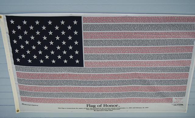 The flag is displayed on the ceiling in Mr. Brickman's Jamesport cottage. (Credit: Joe Werkmeister)