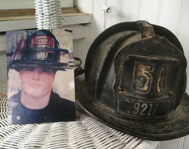A picture of Mr. Brickman from his first year on the job displayed next to his original helmet with Engine 58. (Credit: Joe Werkmeister)