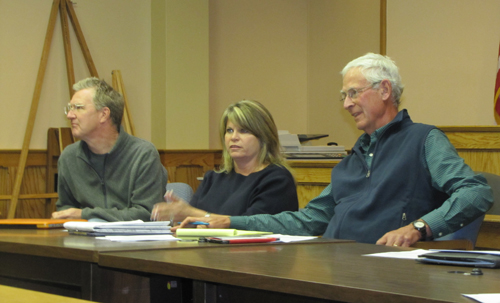 From left, Landmarks Preservation Commission member  Cliff Baldwin, Riverhead Town Councilwoman Jodi Giglio and commission chair Richard Wines listen to speakers at Monday's commission meeting, where a proposal to make a six-mile stretch of Main Road a National Register Historic Place was withdrawn. (Credit: Tim Gannon)