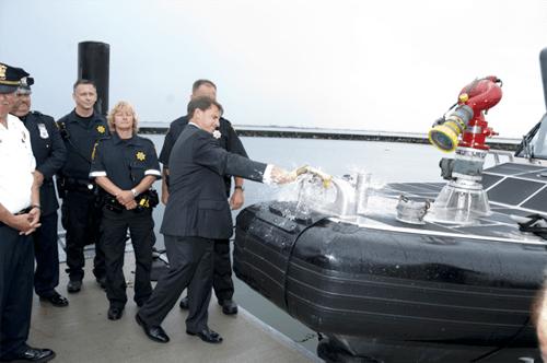 COURTESY PHOTO | Sheriff DeMarco ceremoniously smashes the champagne bottle on the bow of Marine 41.