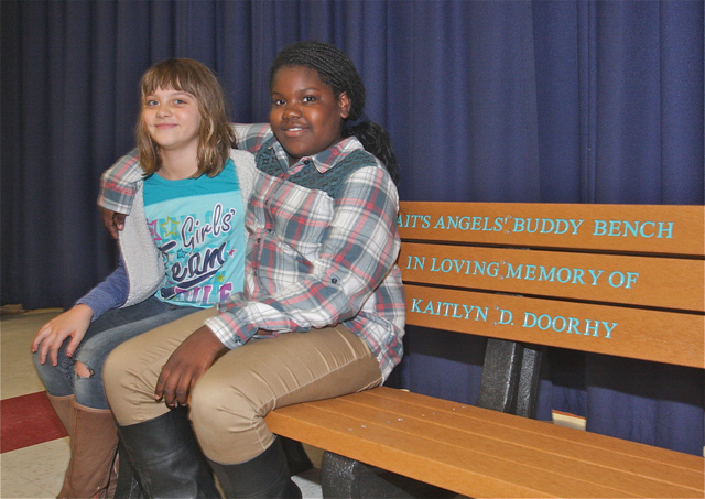 Fourth graders Samantha Davis and Ja'Dah William became friends Friday at recess. Samantha told the principal Phil Kent she was having trouble making friends. (Credit: Barbaraellen Koch)