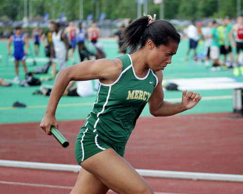 McGann-Mercy's Julianna Cintron runs the opening leg of the 4 x 100 relay at last week's state championship. The team ran again at nationals Friday. (Credit: Hal Henty)