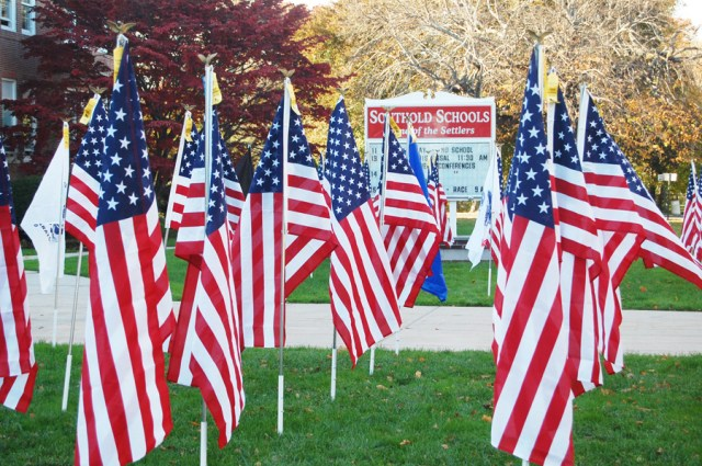 Southold freshmen and faculty members planted dozens of American flags outside the high school for Veterans Day. (Credit: Cyndi Murray)