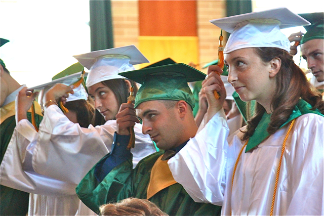 Mercy graduates move their tassels during Thursday's commencement ceremony in Riverhead. (Credit: Robin Bay)