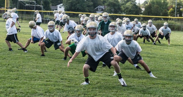 The McGann-Mercy football team practices Tuesday afternoon. (Credit: Robert O'Rourk)