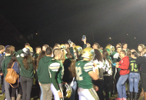McGann-Mercy students celebrated with the players on the field following Friday night's playoff-clinching win. (Credit: Joe Werkmeister)