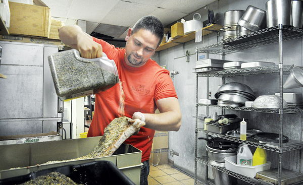 RACHEL YOUNG FILE PHOTO | Patrick Gaeta curing bacon earlier this year.