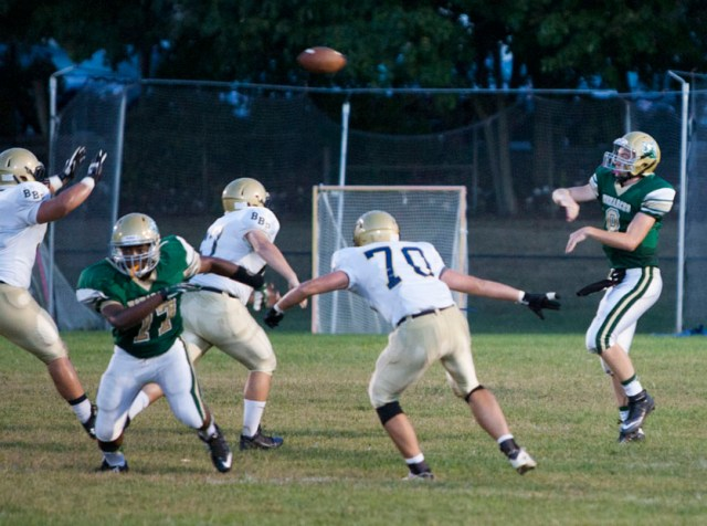 Mercy quarterback Kevin Santacroce lets go a pass as Shelton Williams (77) looks for a block. (Credit: Katharine Schroeder)
