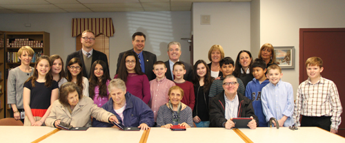 Southold Elementary School fifth graders  along with county Legislator Al Krupski and county Executive Steven Bellone taught Southold seniors Ana Balarezo, Judy Ollarty, Lena Raiser and Bill Faye how to use tablet computers Wednesday afternoon. (Credit: Carrie Miller)
