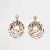 Red multicoloured beaded circle drop earrings - Earrings ...