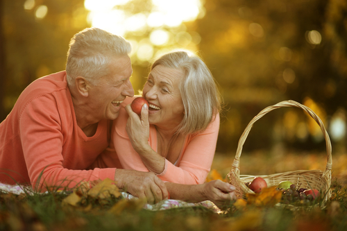 couple with implant supported dentures