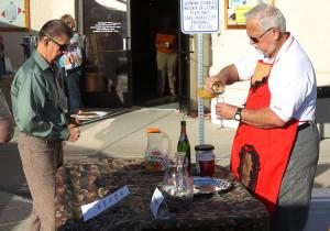 Gary Bjornson pours a Mimosa Saturday morning at the Robert McCulloch Birthday Bash. Jillian Danielson/RiverScene