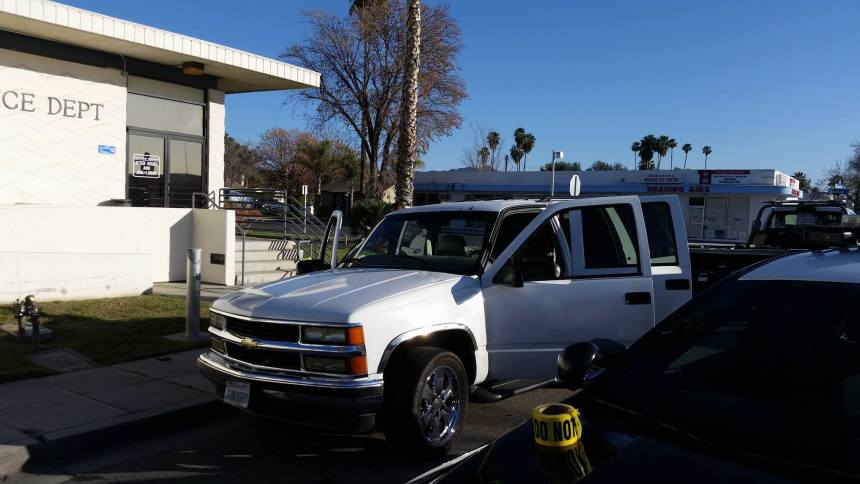 A white SUV is processed for evidence after the vehicle was shot at multiple times in Hemet. J.P.Kemp photo