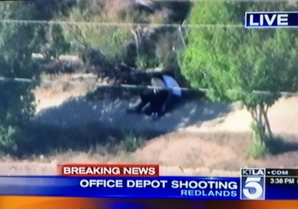 A suspect is currently holding a woman described as his girlfriend hostage in Redlands, following a shooting at Office Depot.