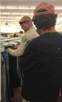 Deputy Gurganious of the Temecula Police Department helps a man shop for some new clothes, which he then paid for. Pamela Johnson photo
